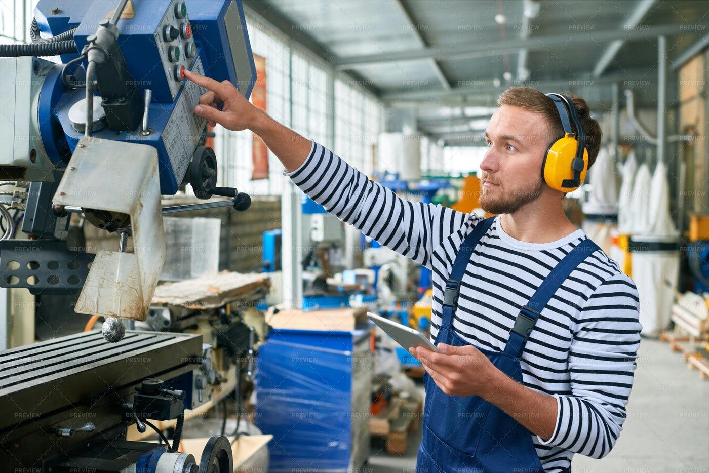 Young Machine Operator At Modern...: Stock Photos