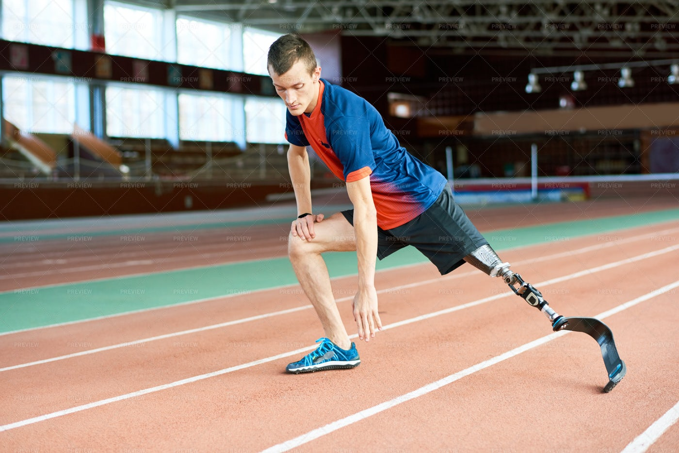 Handicapped Runner Stretching In...: Stock Photos