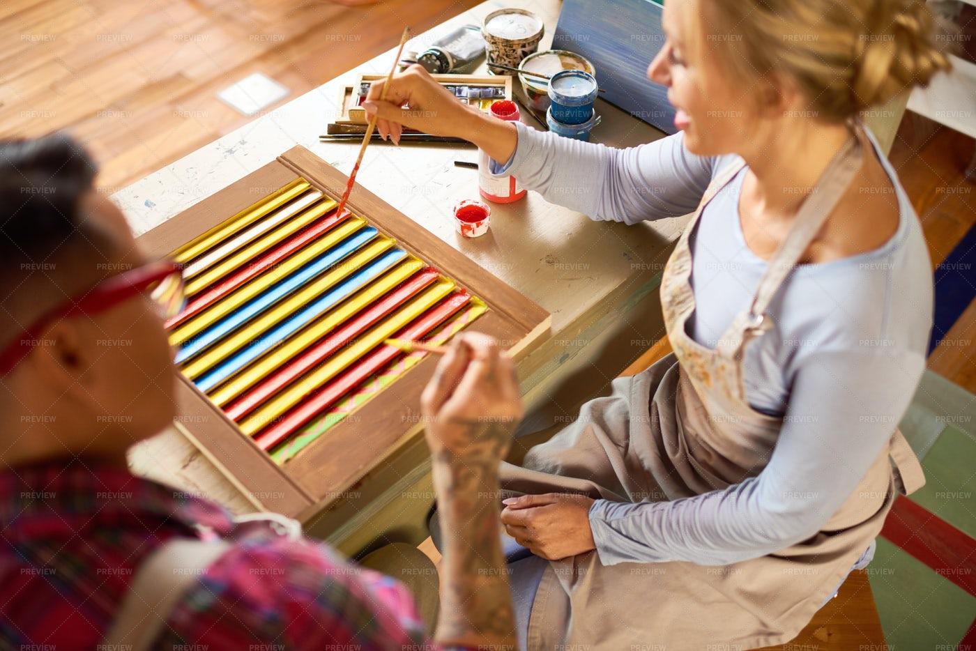 Two Women Working In Art Studio: Stock Photos