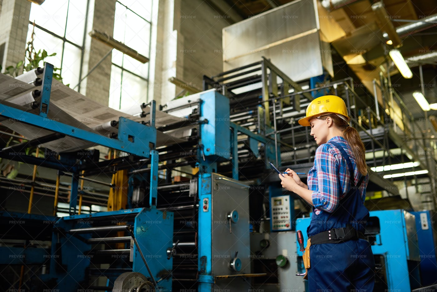 Female Factory Worker Overseeing...: Stock Photos