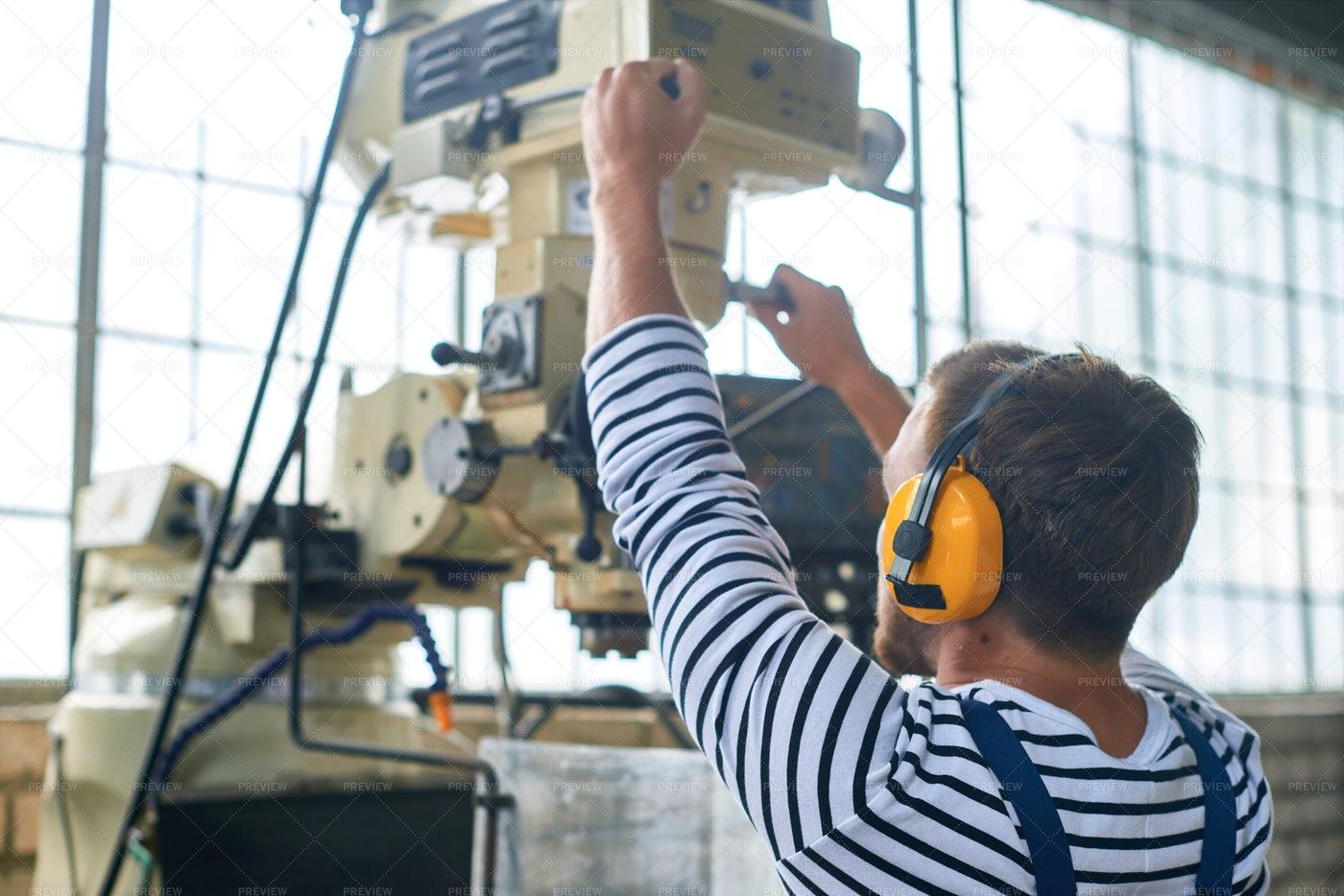 Worker Operating Machine Units: Stock Photos
