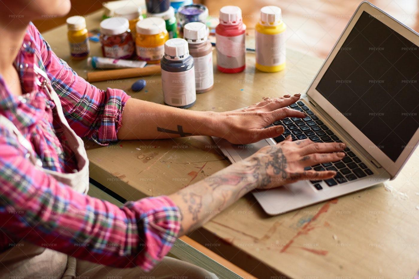 Tattooed Woman Using Laptop: Stock Photos