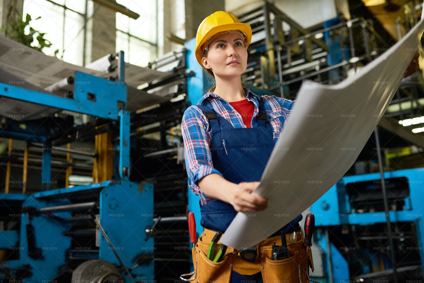 Female Factory Worker Checking...: Stock Photos