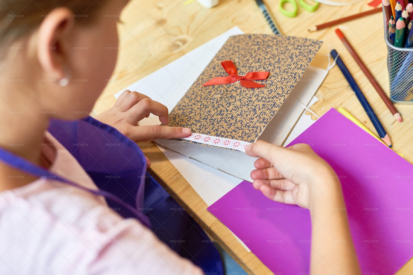 Girl Making Handmade Card For Mom: Stock Photos