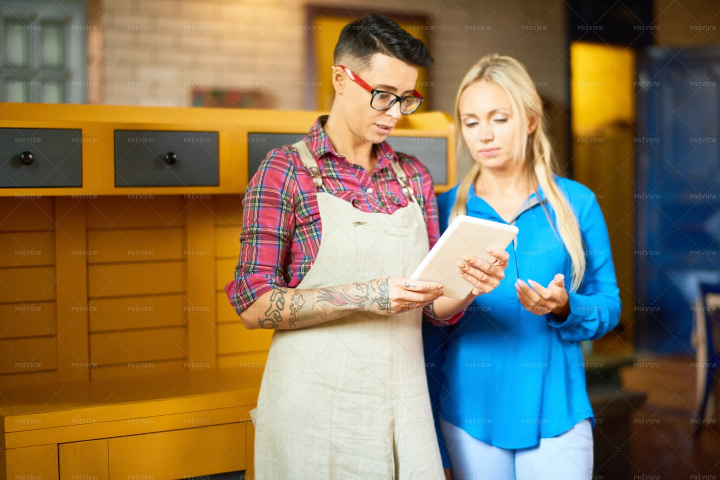 Two Creative Women Discussing Work: Stock Photos