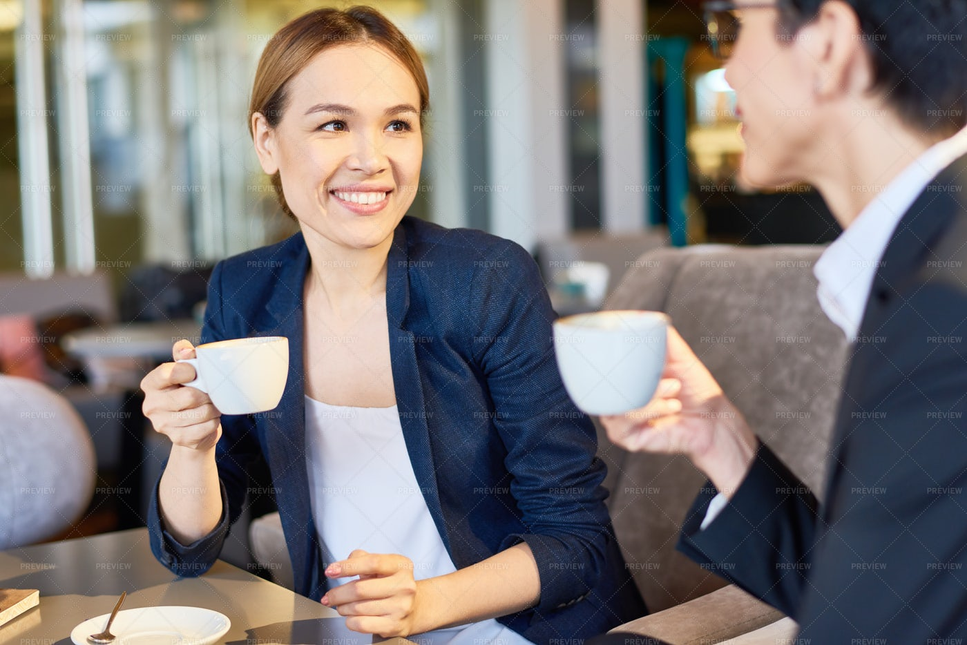 Chatting With Colleague At Coffee...: Stock Photos