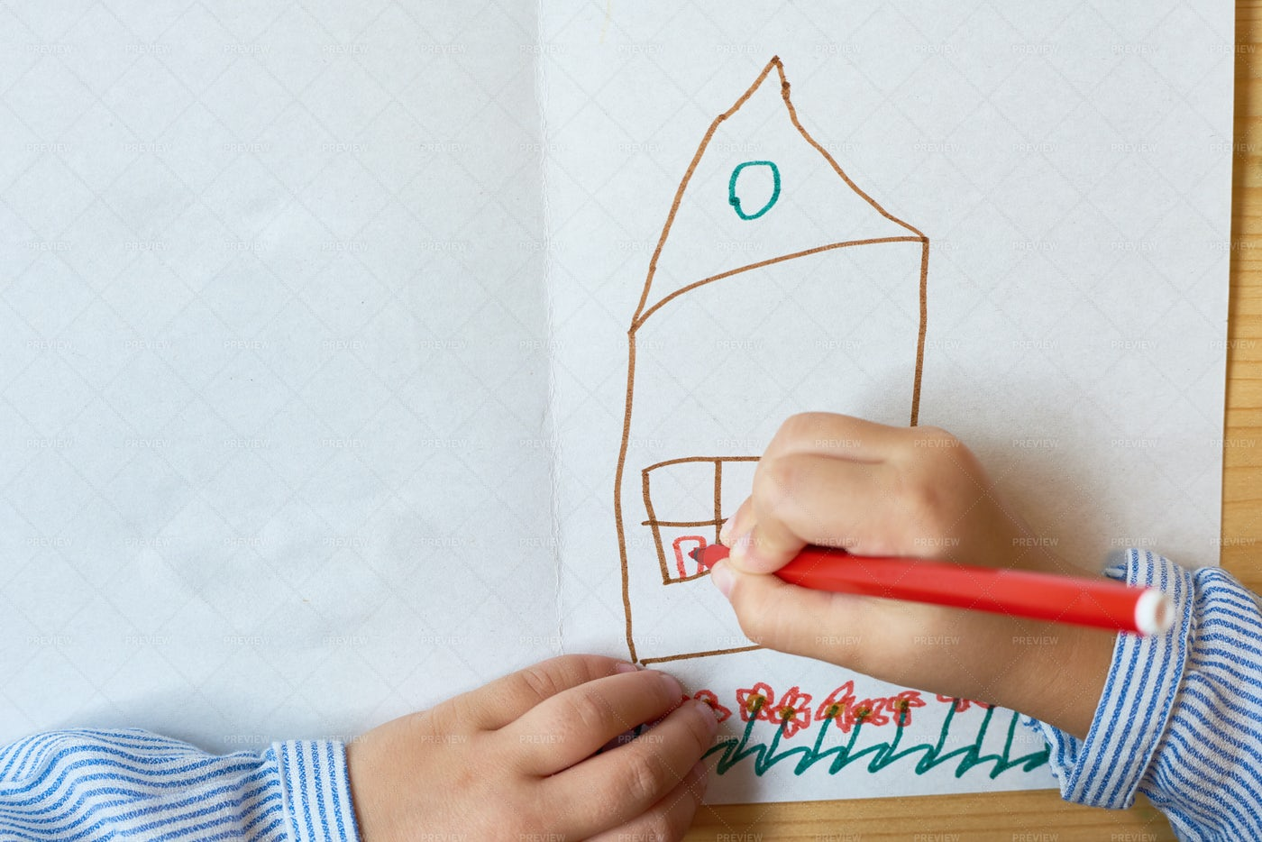 Little Child Drawing House: Stock Photos