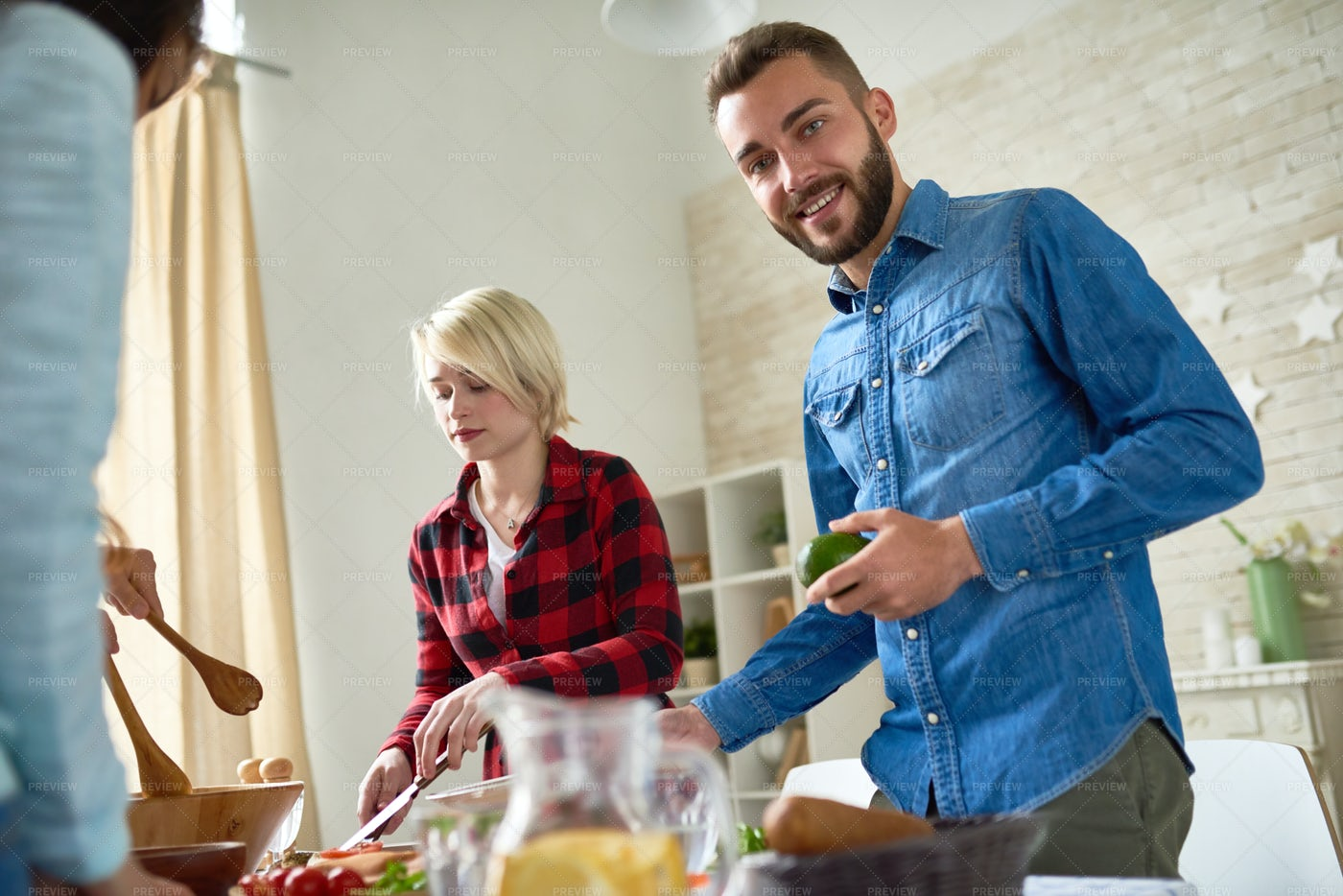 Friends Preparing Dinner Together: Stock Photos