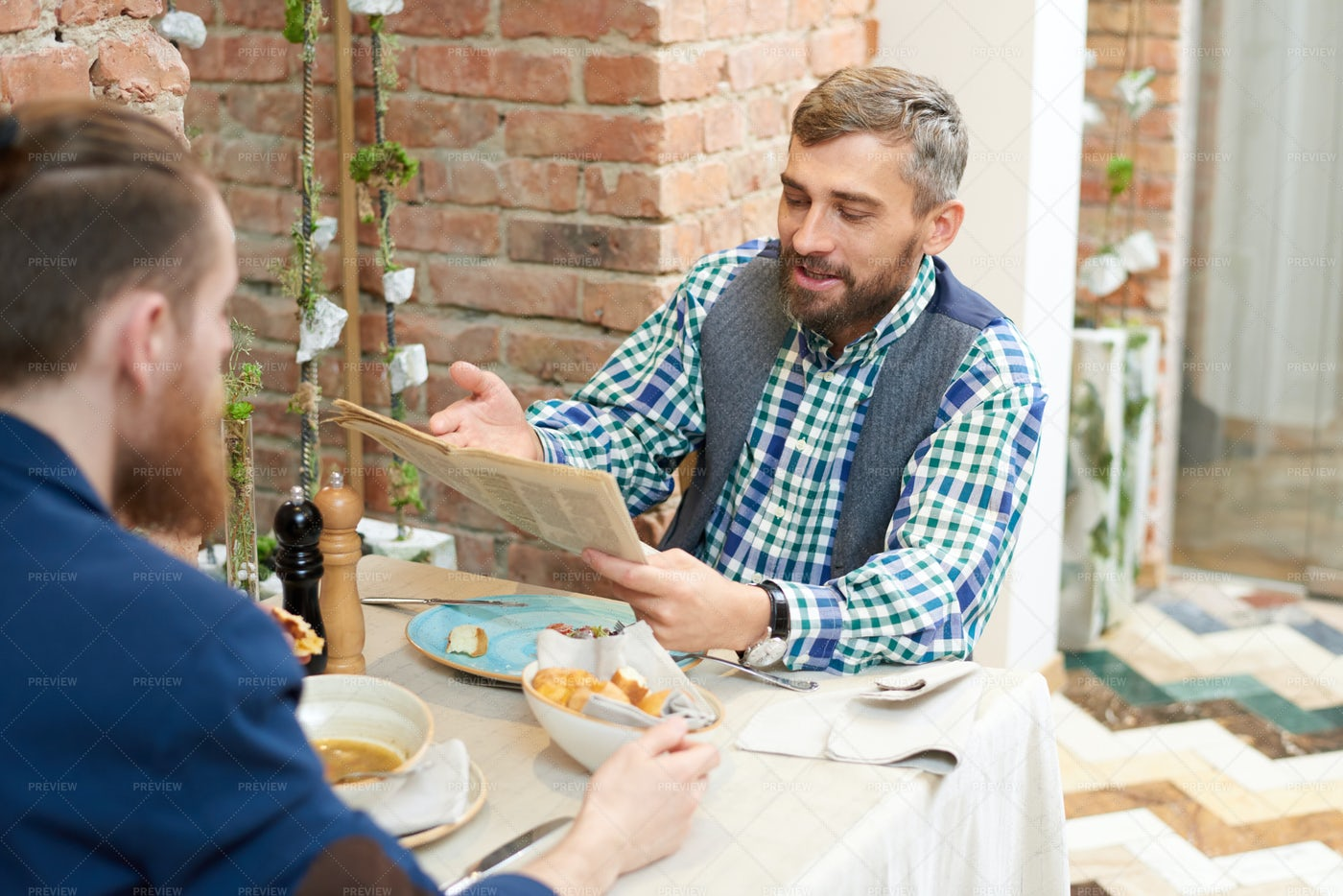 Discussing Newspaper Article With...: Stock Photos