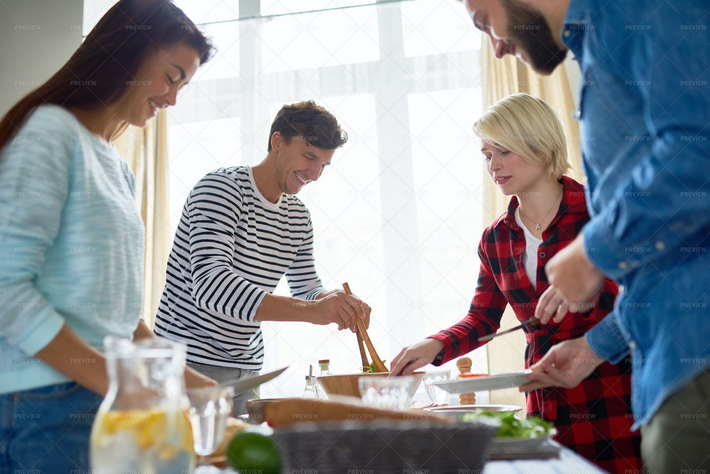 Four Friends Preparing  Dinner...: Stock Photos