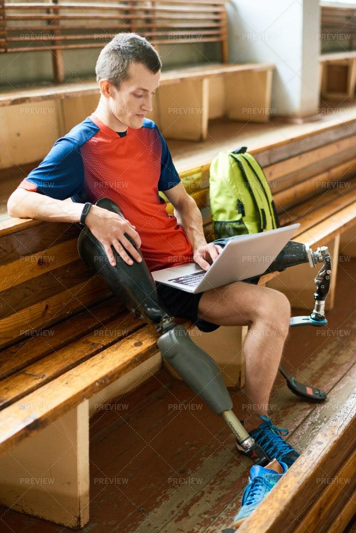Handicapped Sportsman Using Laptop: Stock Photos