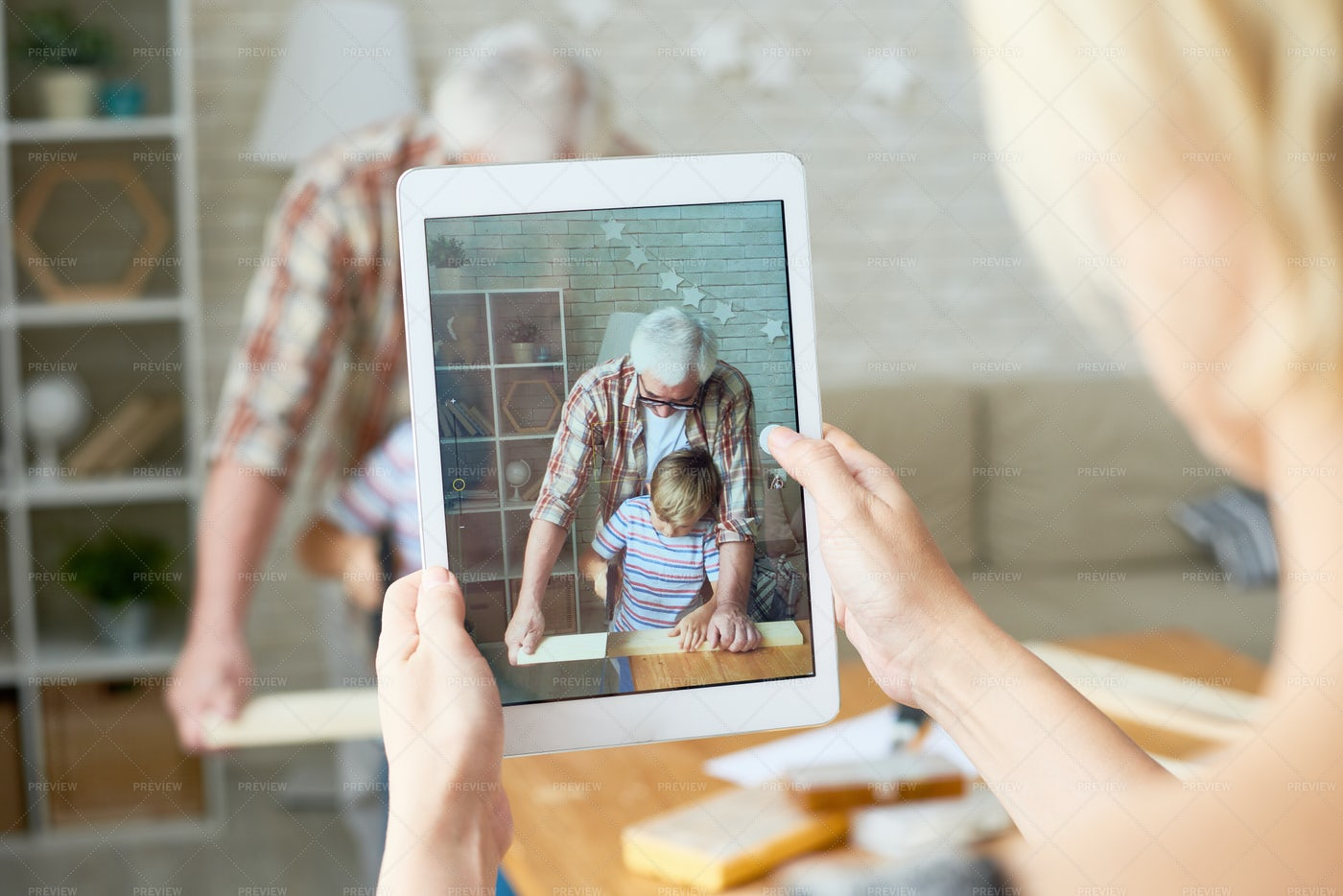 Grandfather And Grandson On Screen...: Stock Photos