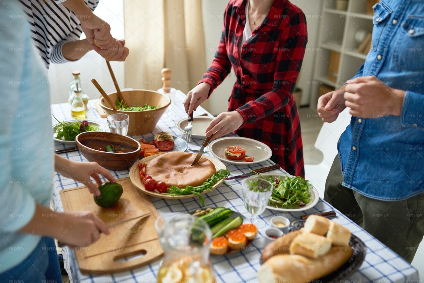 Young People Preparing Dinner...: Stock Photos