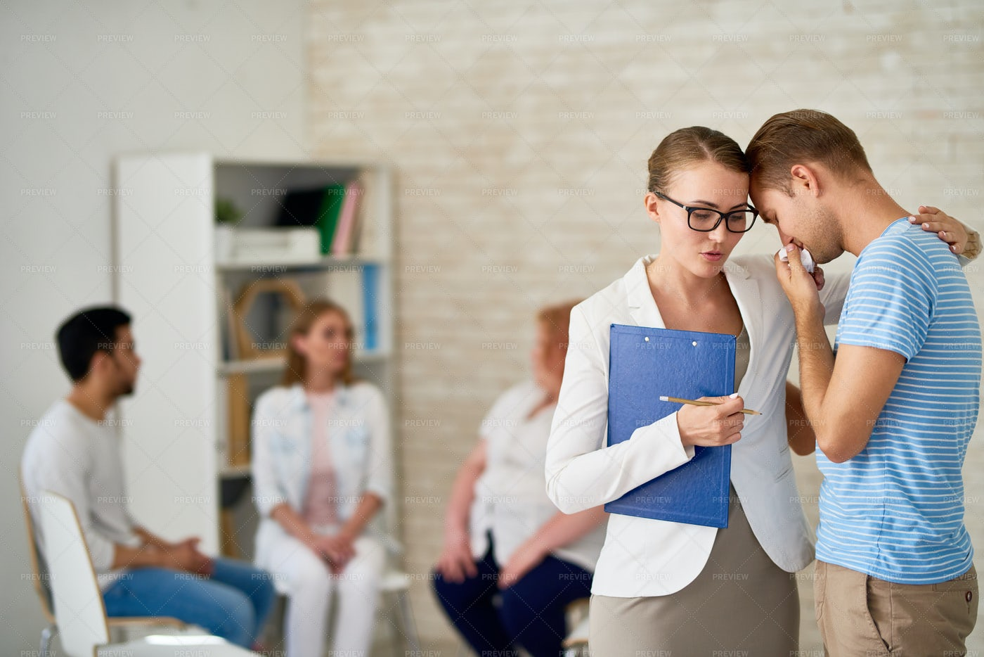 Crying Young Man At Group Therapy...: Stock Photos
