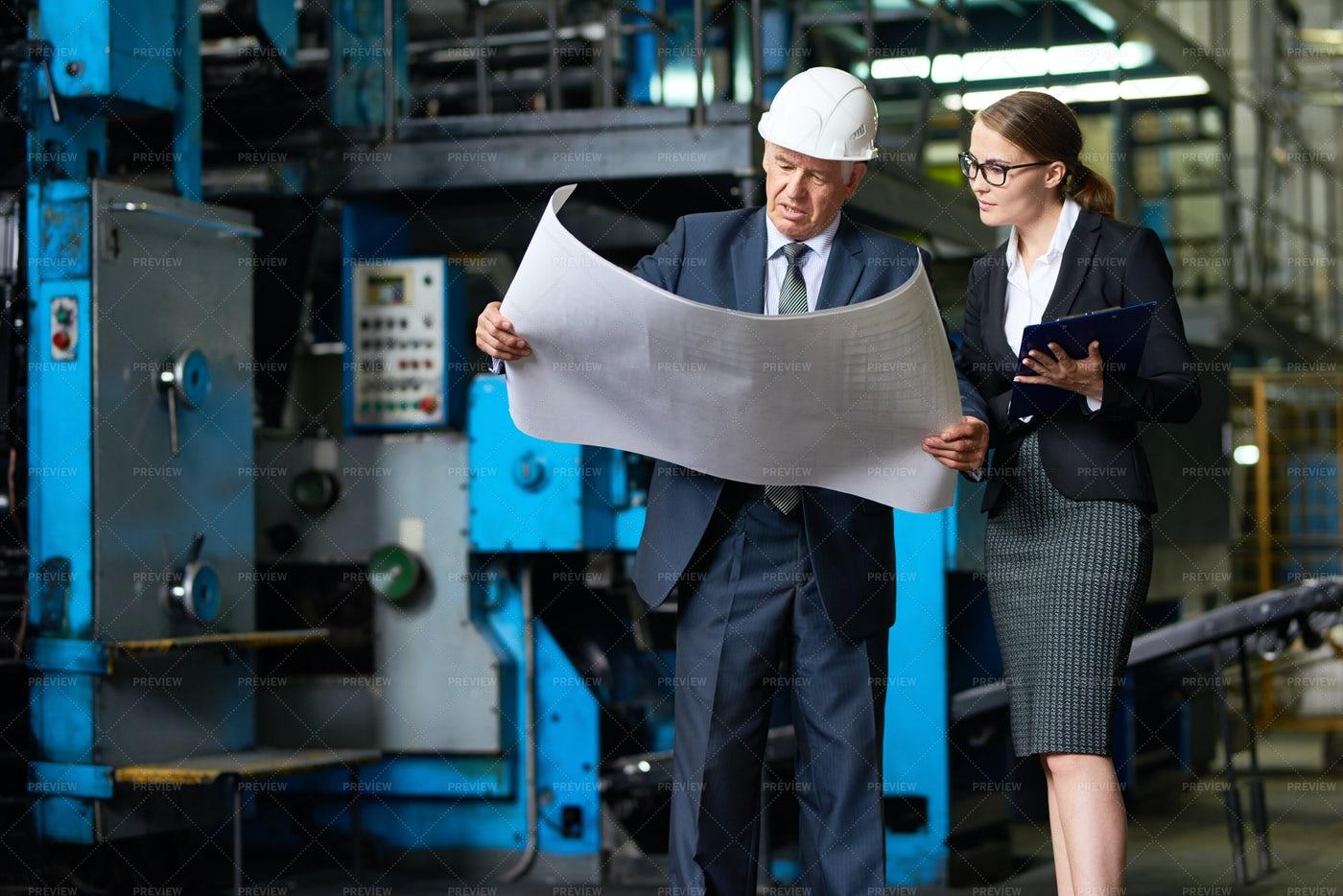Senior Inspector Looking At Factory...: Stock Photos