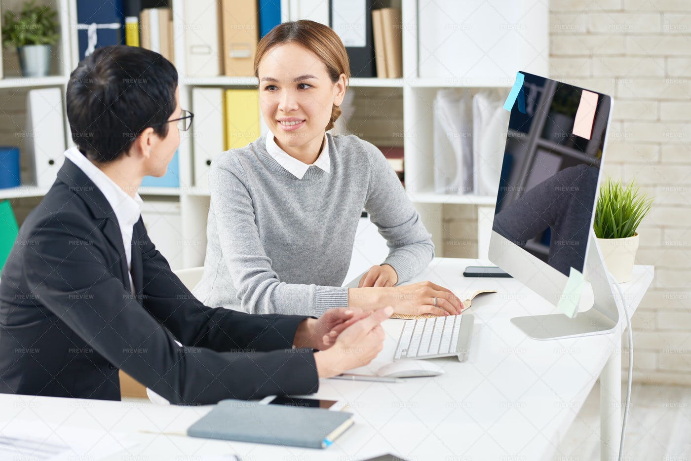 Working Meeting At Open Plan Office: Stock Photos