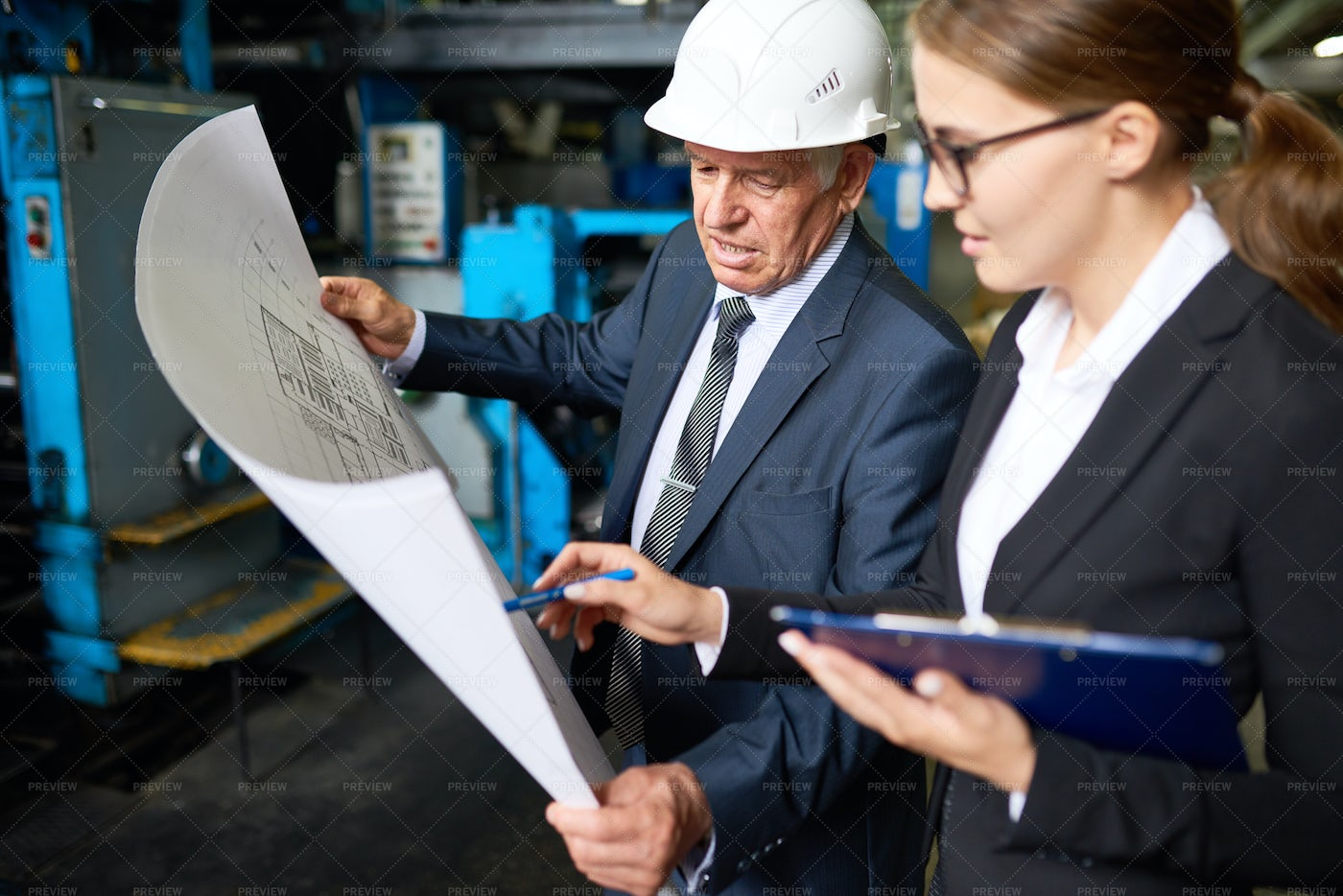 Senior Manager Discussing  Factory...: Stock Photos