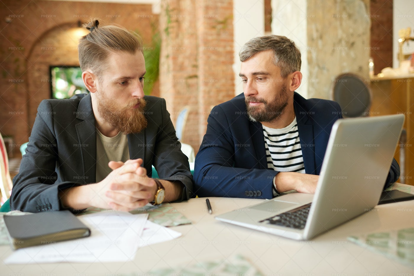 Discussing Cooperation With...: Stock Photos