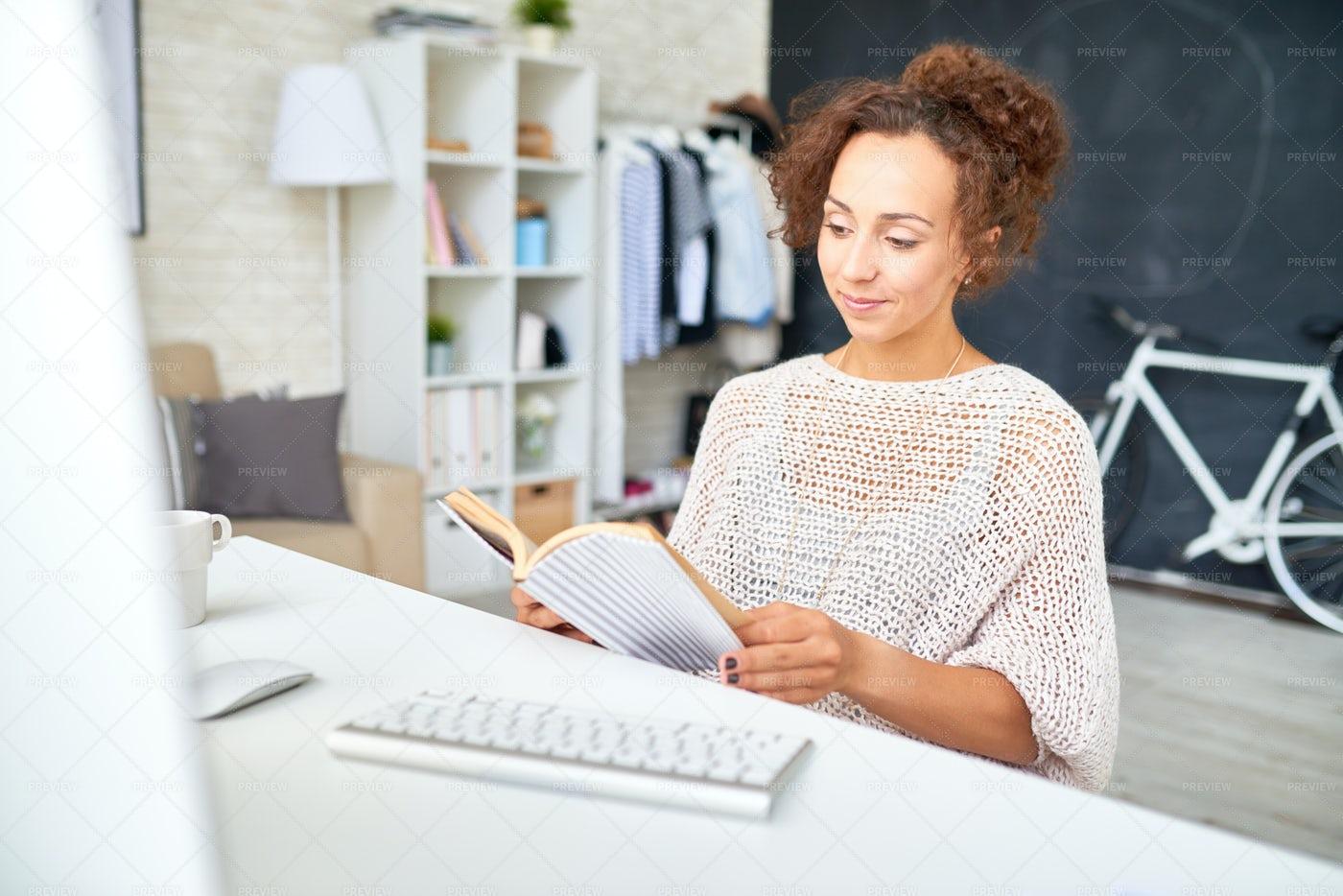 Mixed-Race Woman Relaxing At Desk...: Stock Photos