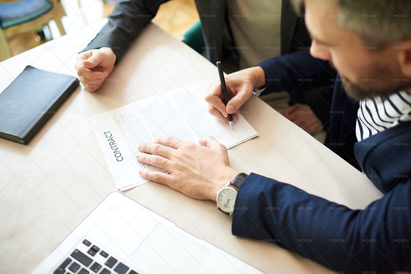 Signing Contract With Business...: Stock Photos