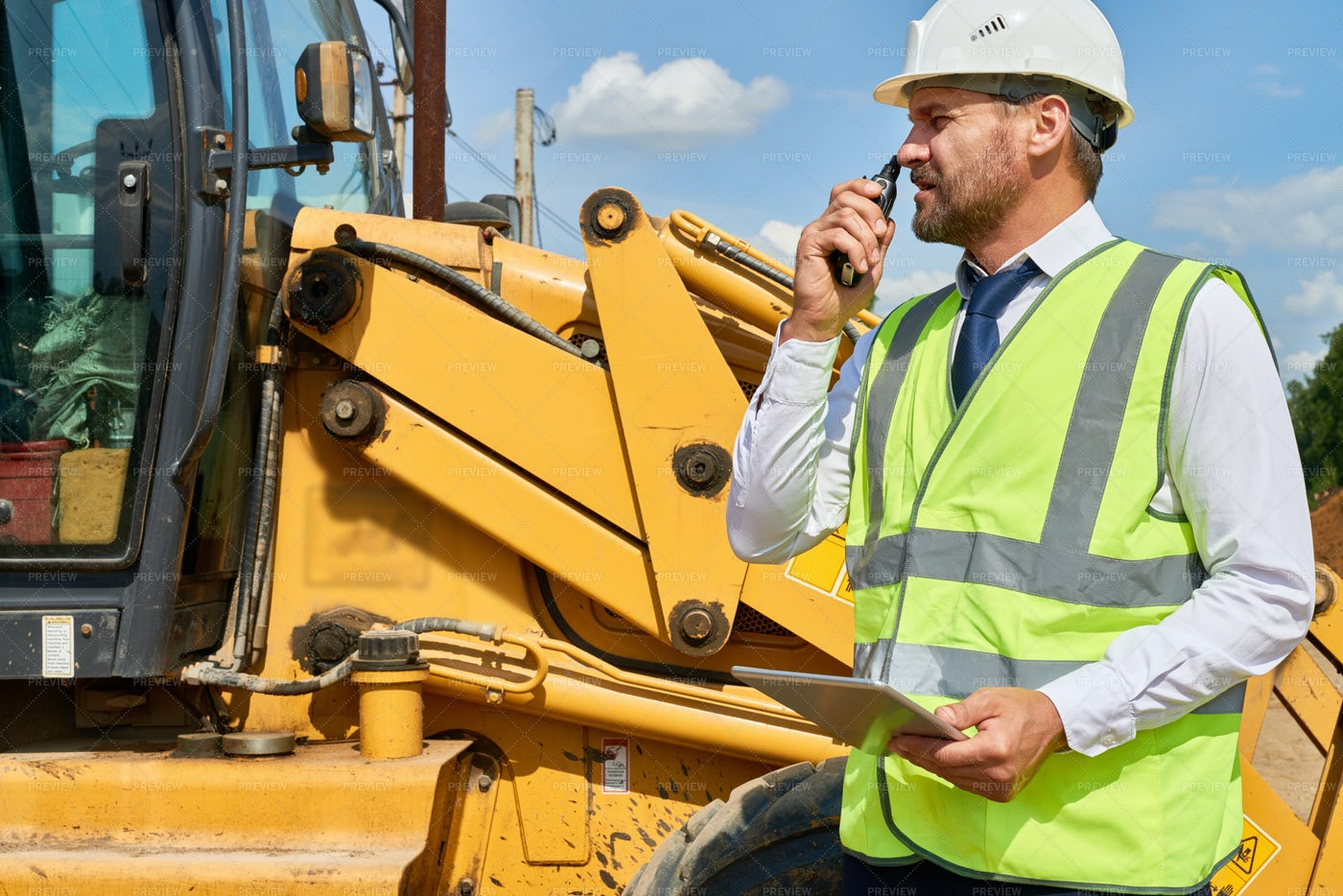 Busy Construction Worker In Suit: Stock Photos