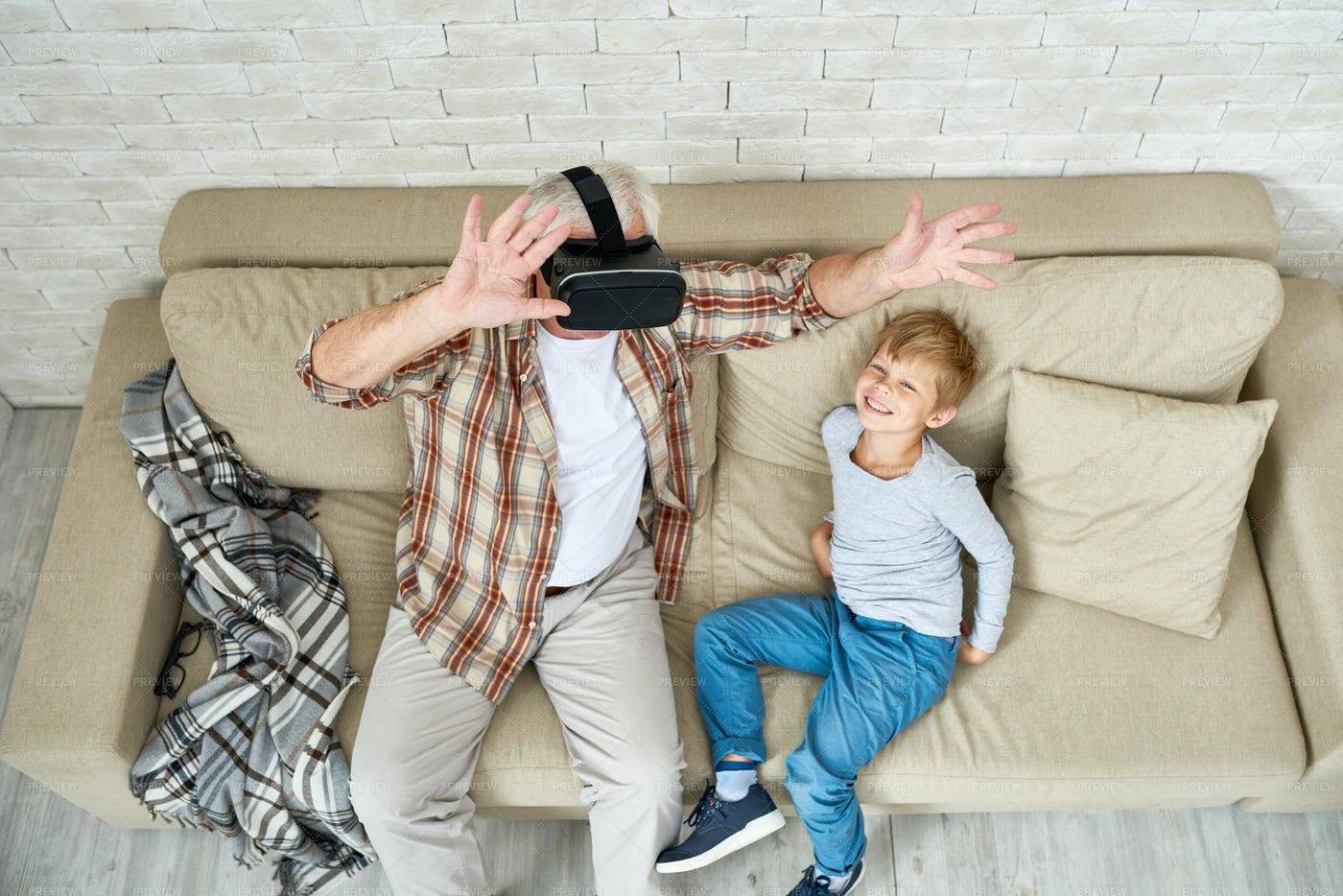 Excited Senior Man Using VR: Stock Photos