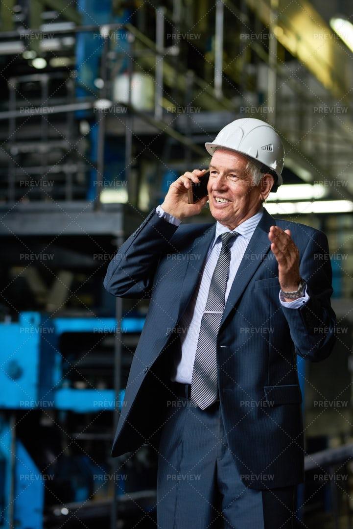 Senior Businessman Speaking By...: Stock Photos