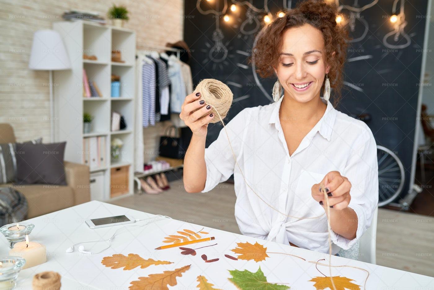 Creative Woman Making Autumn Leaves...: Stock Photos
