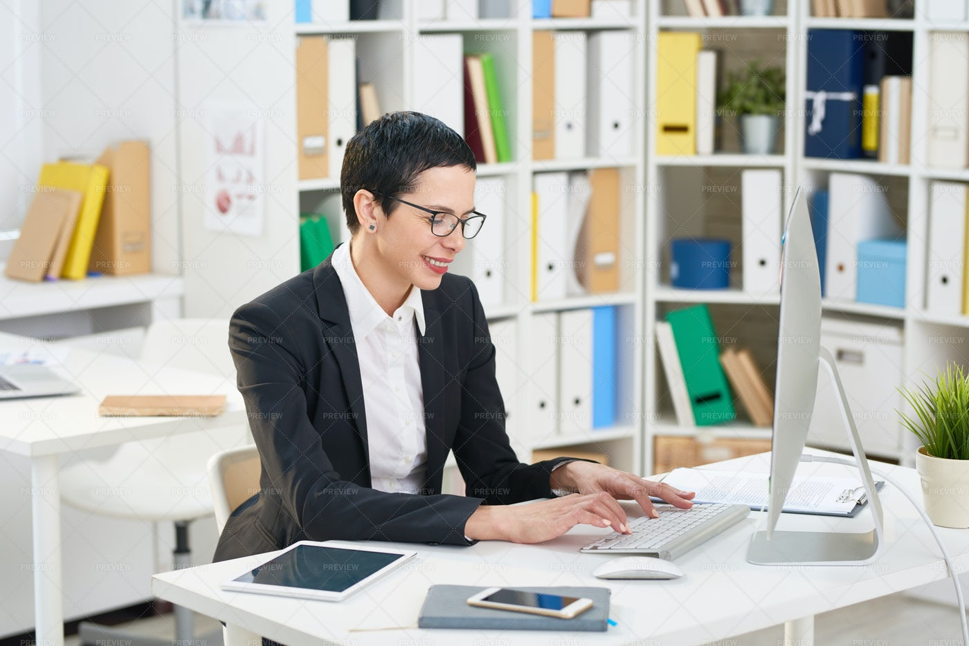 Pretty Manager Wrapped Up In Work: Stock Photos