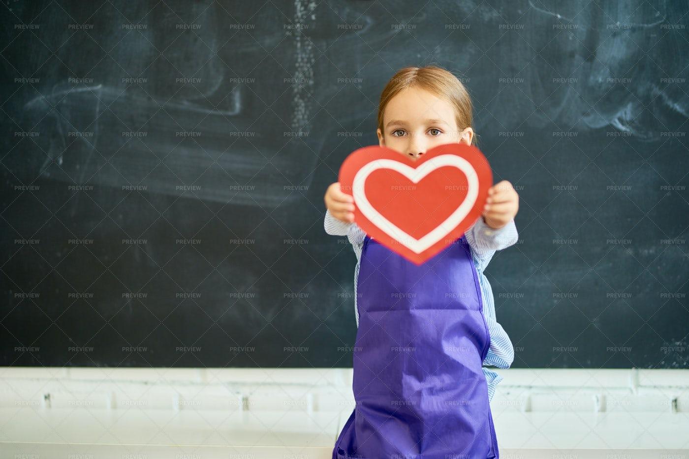 Little Child Holding Heart: Stock Photos