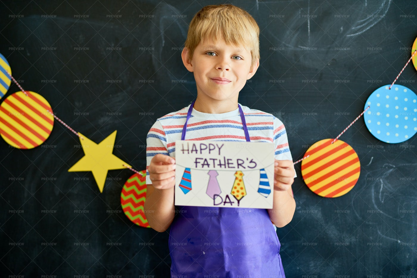 Little Boy Holding Gift Card For...: Stock Photos