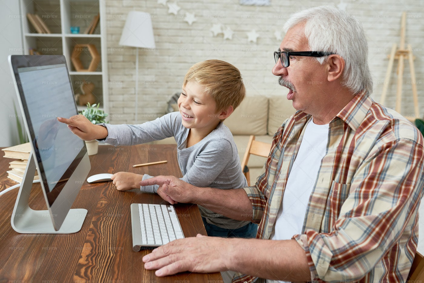 Little Boy Teaching Grandpa...: Stock Photos
