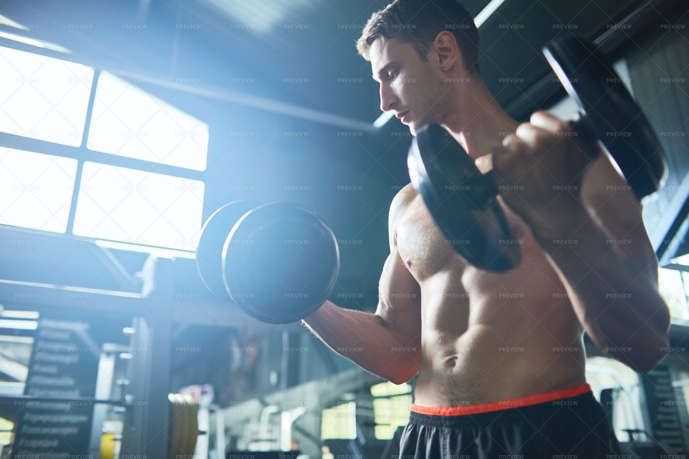 Strong Man Working Out In Gym: Stock Photos