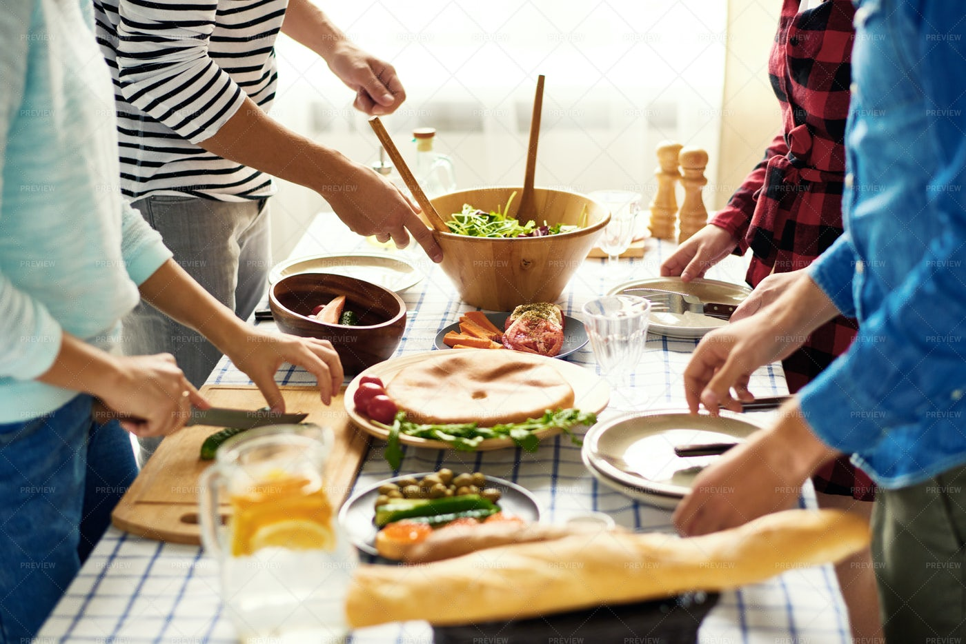 Friends Making Dinner Together: Stock Photos