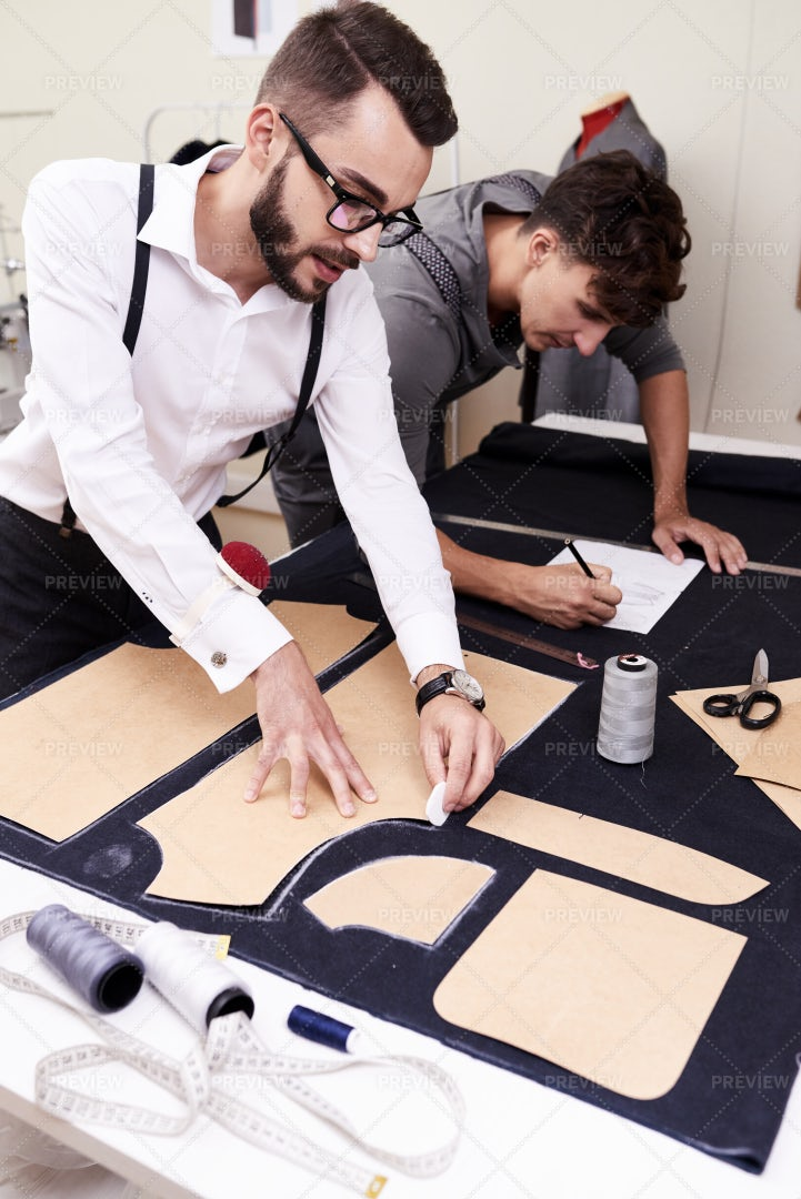 Male Fashion Designers  Working In...: Stock Photos