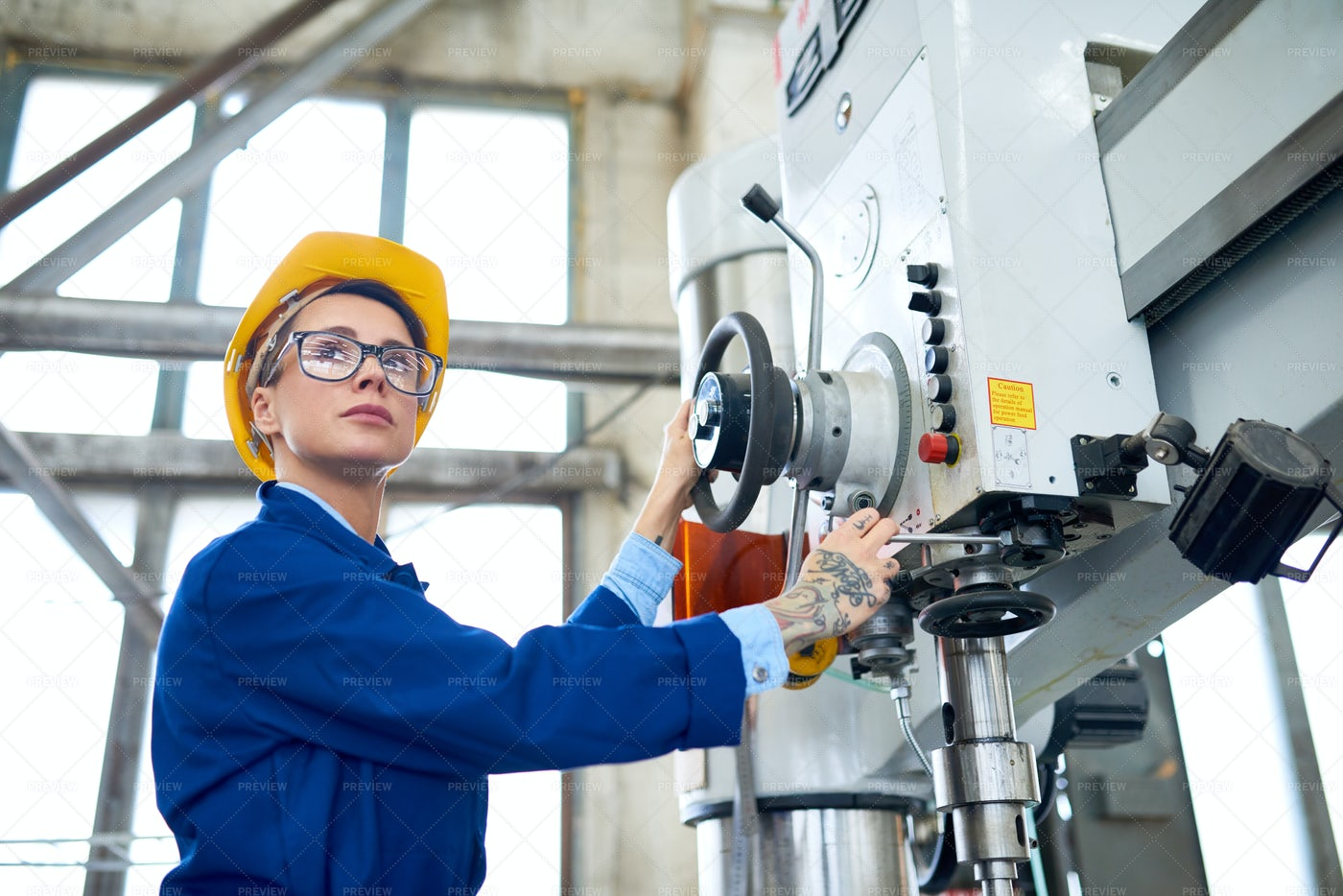 Operating Bench Drilling Machine: Stock Photos