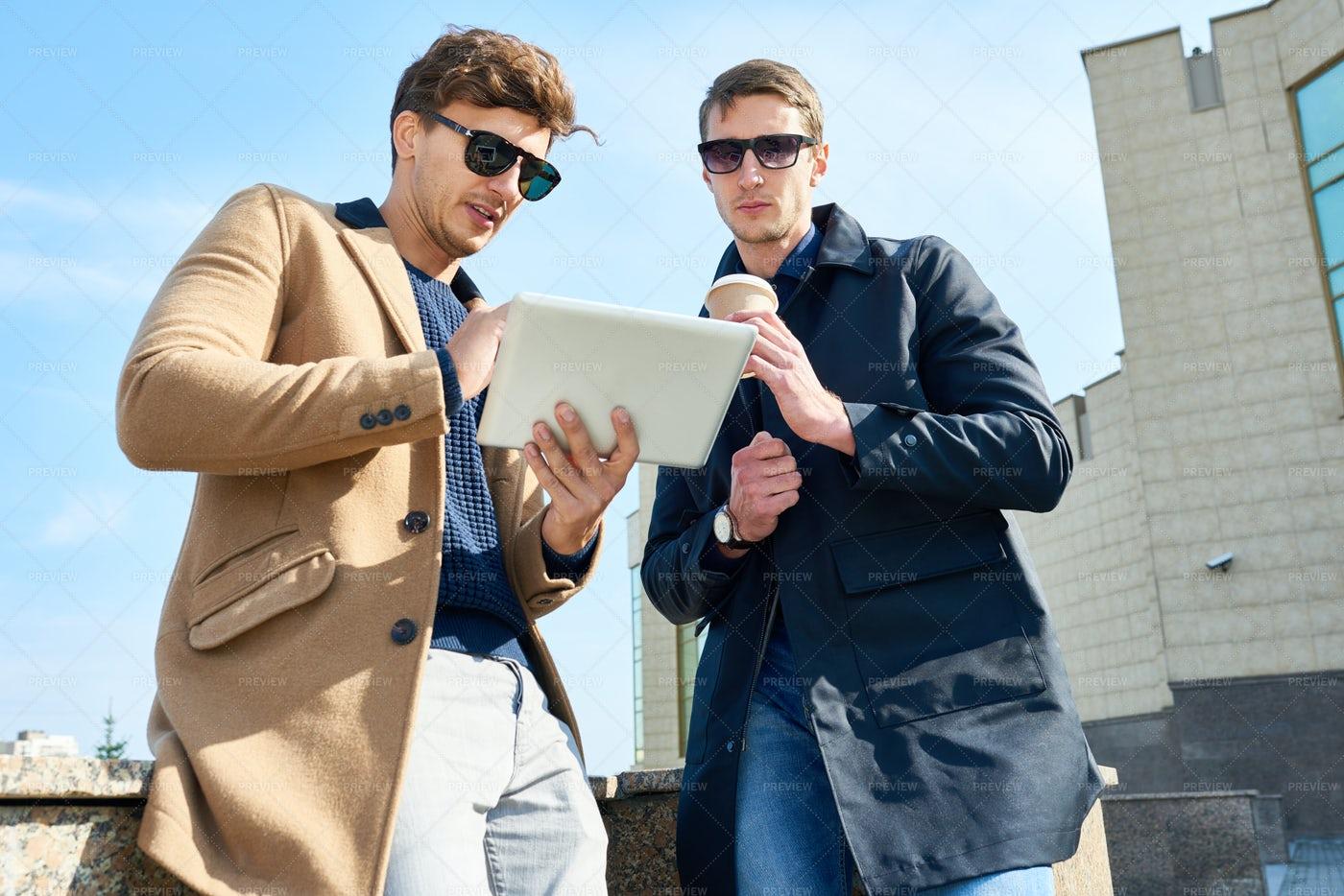 Stylish Young Men Using Digital...: Stock Photos