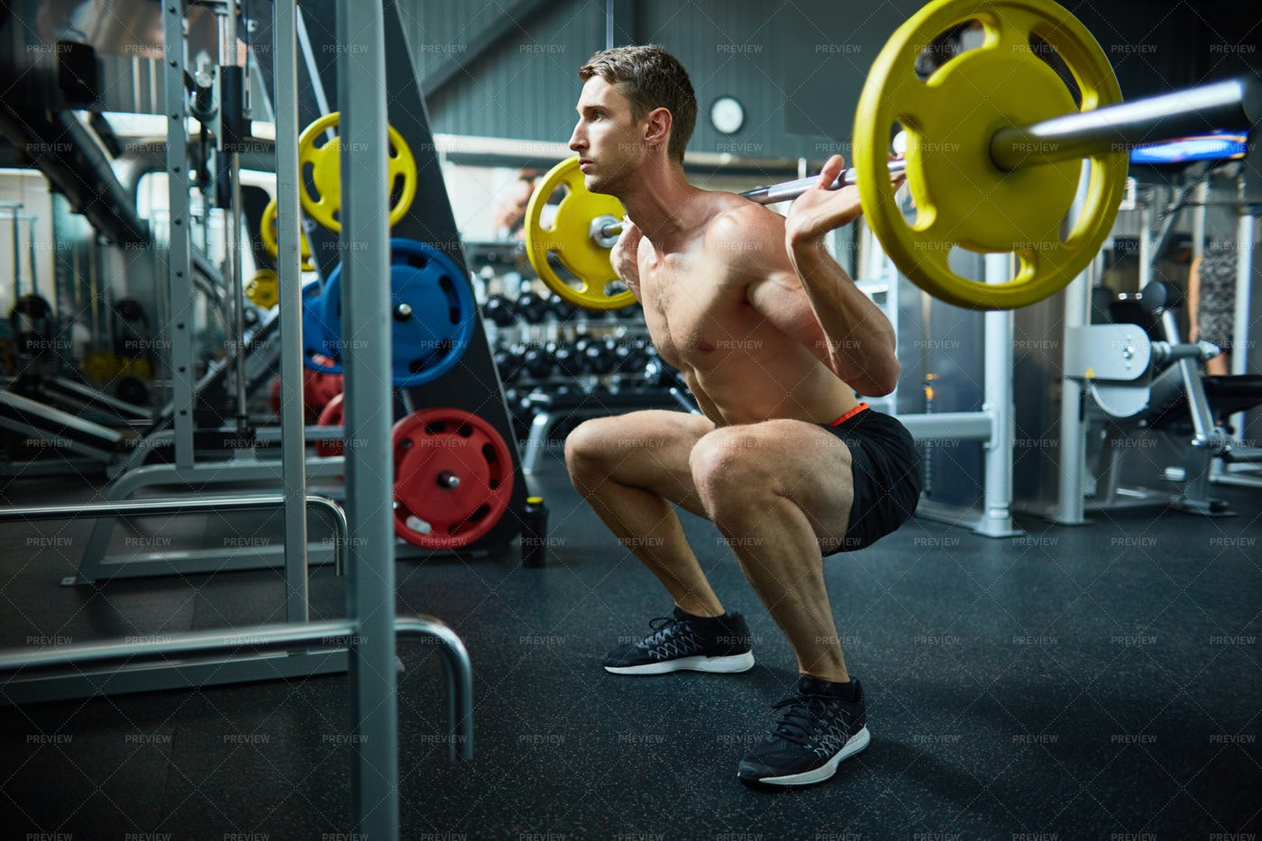 Handsome Man Squatting With Barbell: Stock Photos