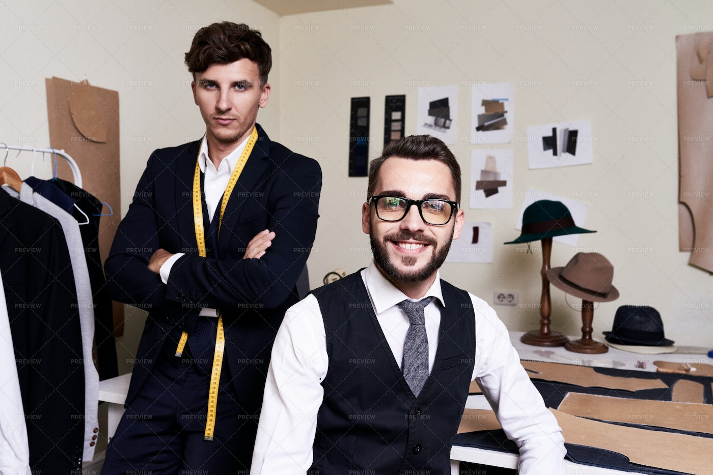 Handsome Tailors  Posing In Atelier: Stock Photos