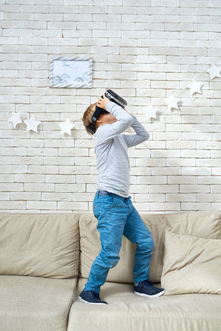 Little Boy Watching 360 Videos: Stock Photos
