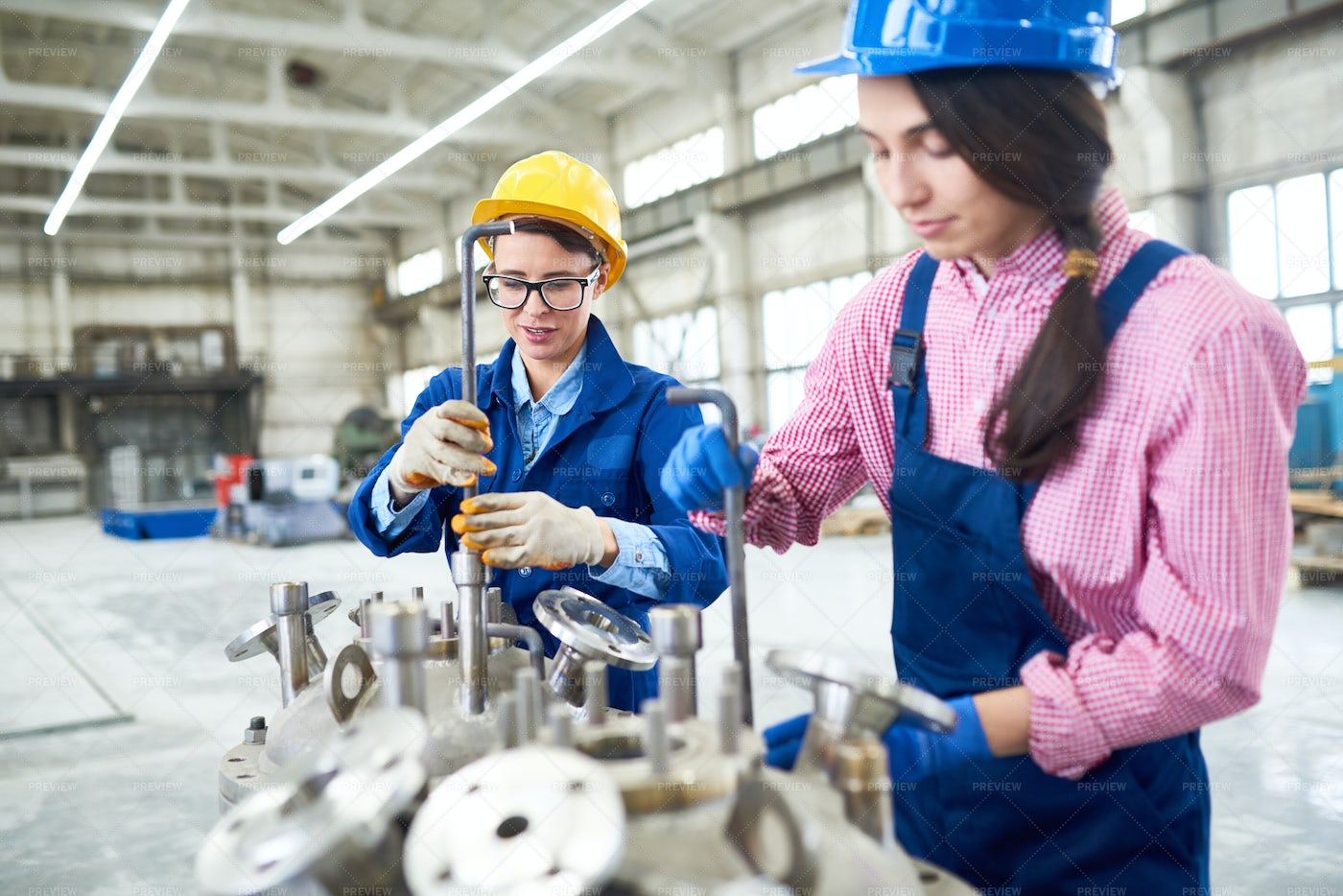 Factory Workers Using Hex Keys: Stock Photos