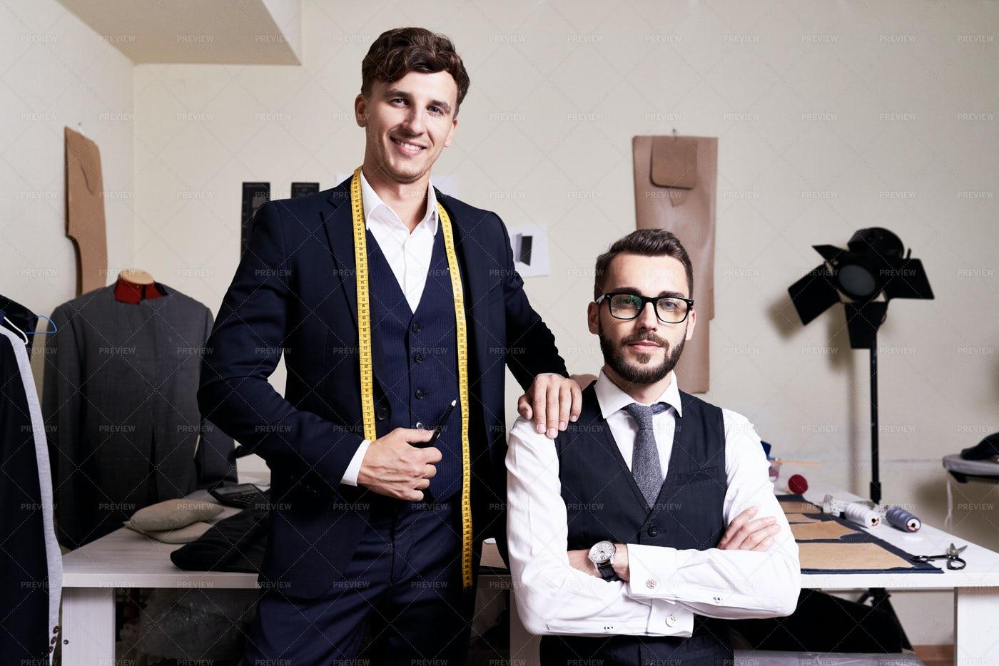 Modern Fashion Designers In Atelier: Stock Photos