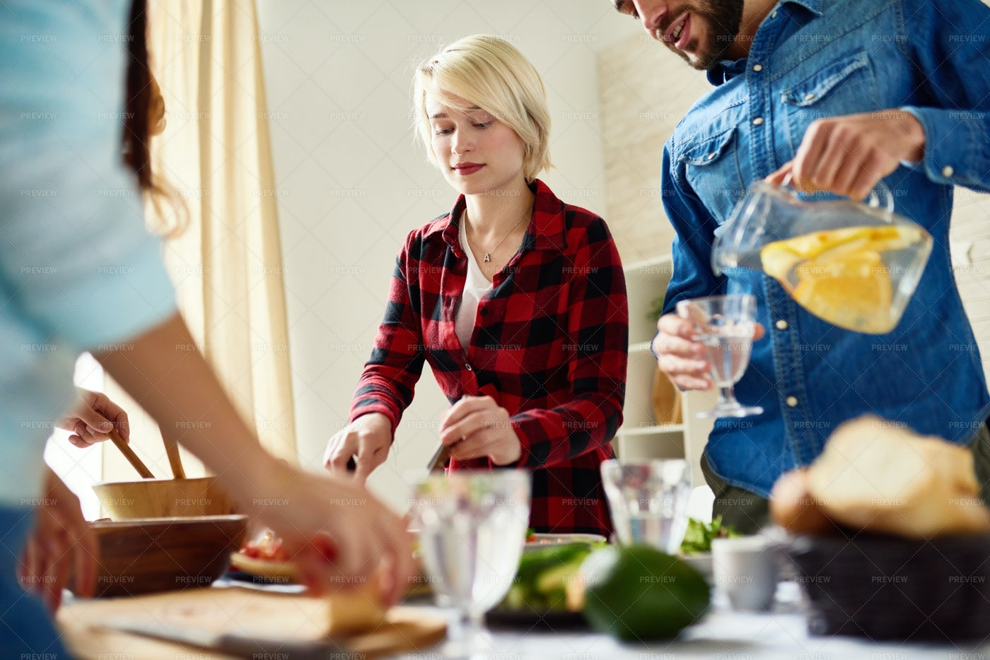 Friends Cooking Dinner Together: Stock Photos