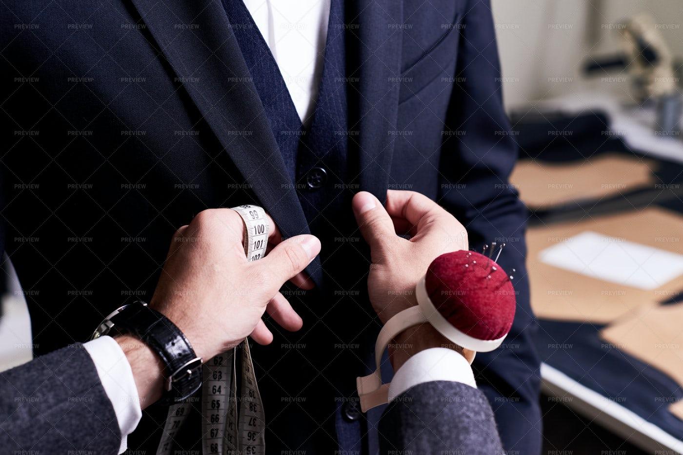 Tailor Pinning Custom Suit: Stock Photos