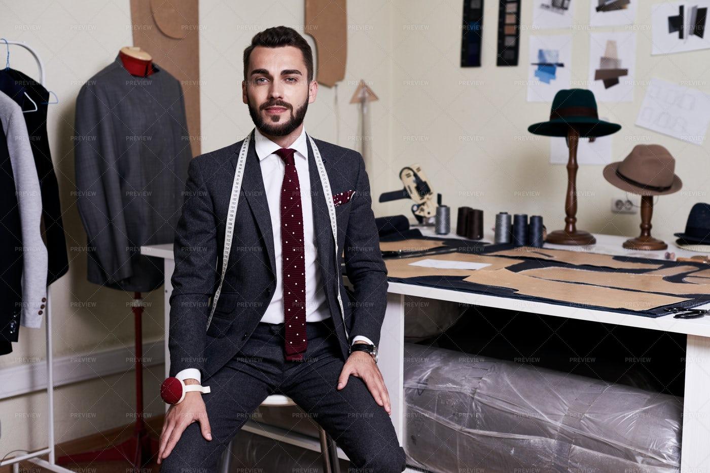 Modern Tailor In Atelier: Stock Photos