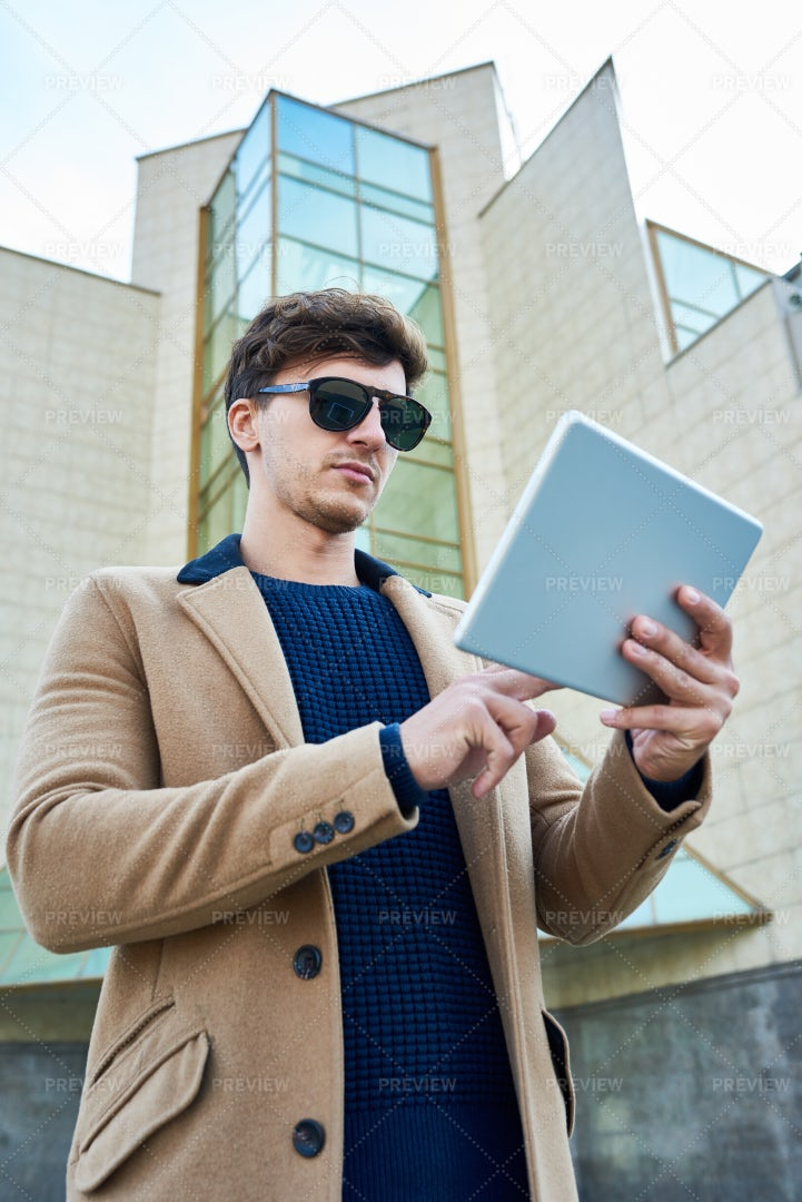 Handsome Businessman Using Tablet...: Stock Photos