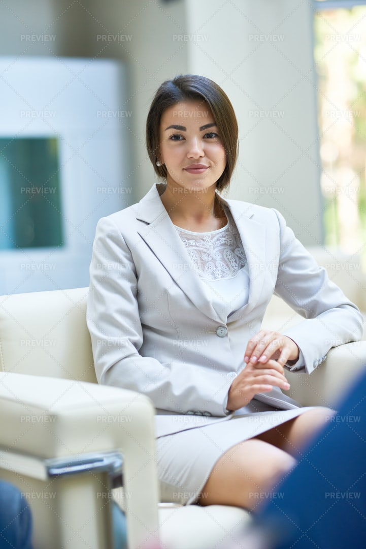 Young Business Woman Listening To...: Stock Photos