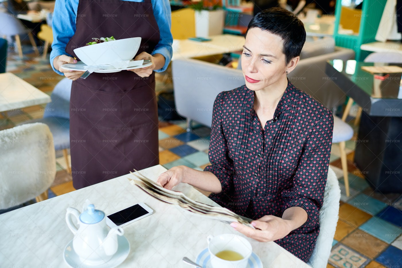 Elegant Woman Waiting For Order In...: Stock Photos