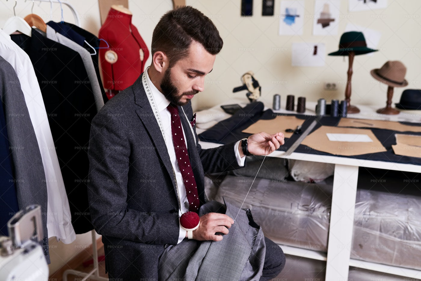 Handsome Tailor Making Jacket In...: Stock Photos