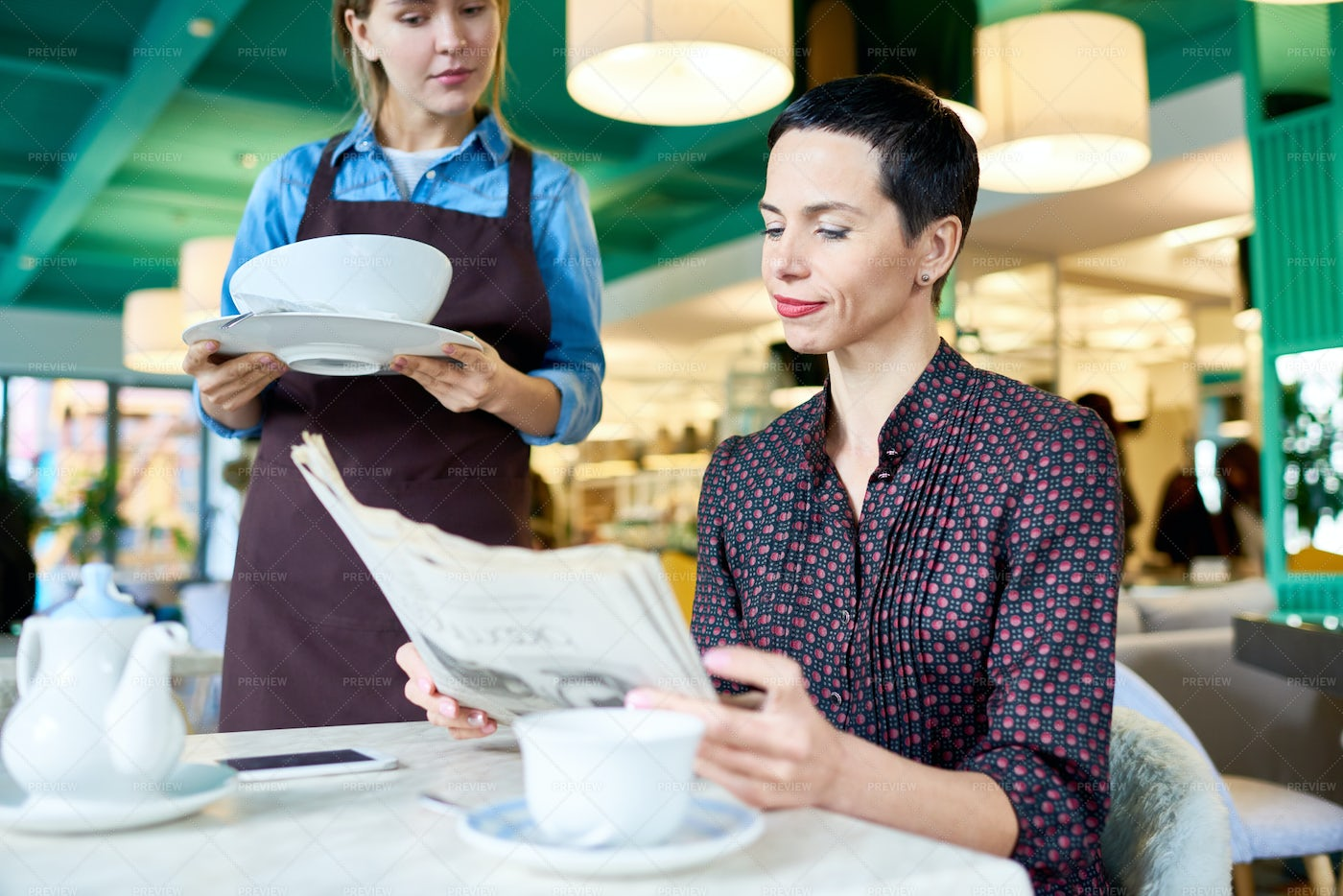 Elegant Woman Waiting For Food In...: Stock Photos